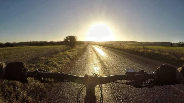 POV Sports riding a mountain bike on a countryside road on a cold winter day in Oxfordshire, England stock photo