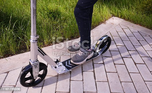 665192886 istock photo Sports scooter for children and adults 1161738596