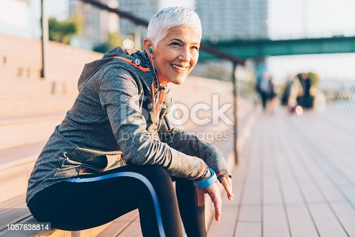 Beautiful senior woman resting after work out outdoor