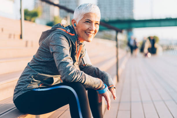 Sports senior woman Beautiful senior woman resting after work out outdoor young at heart stock pictures, royalty-free photos & images