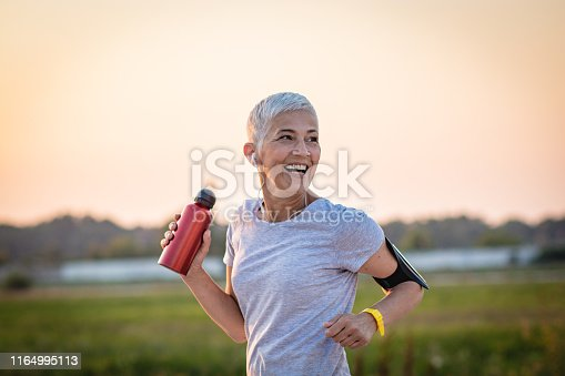 Mature Woman Running on the running track