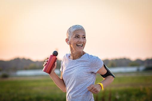 Mature Woman Running on the running track