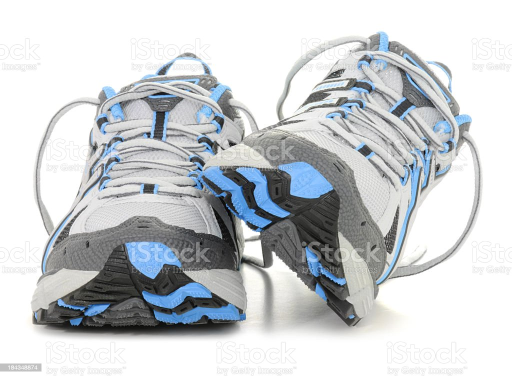 Sports shoes in white and blue colors royalty-free stock photo