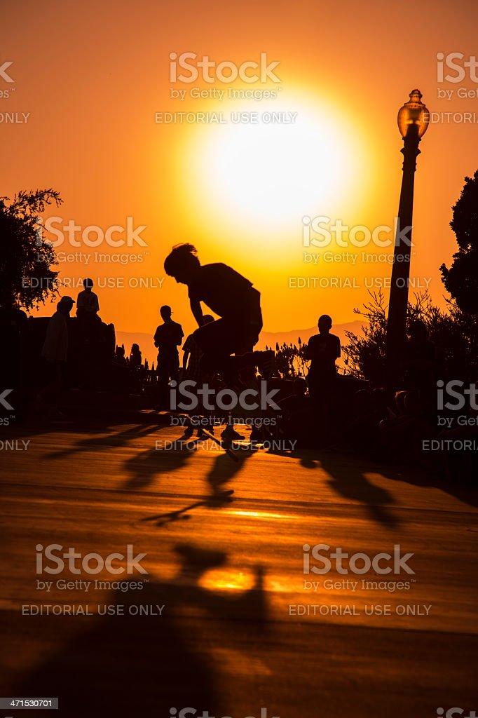 Sports: Sillouette of skateboarder doing a trick at sunset royalty-free stock photo