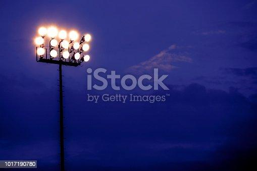 Sports stadium lights at dusk, night.  Dramatic sky.  Football, baseball, or soccer field.