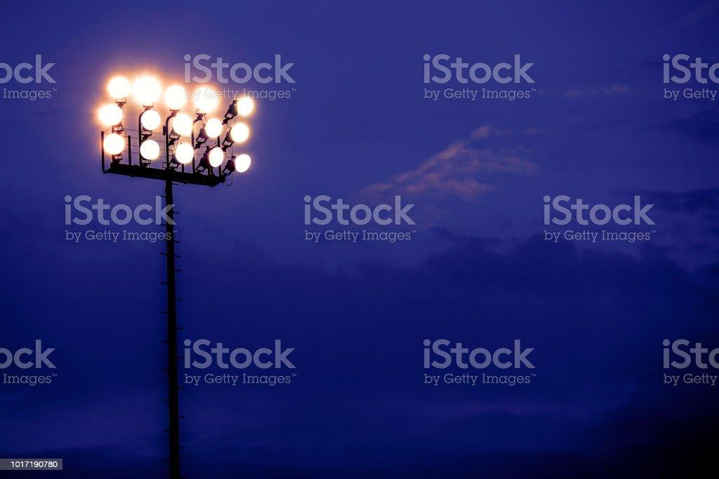 Sports stadium lights at dusk, night. stock photo