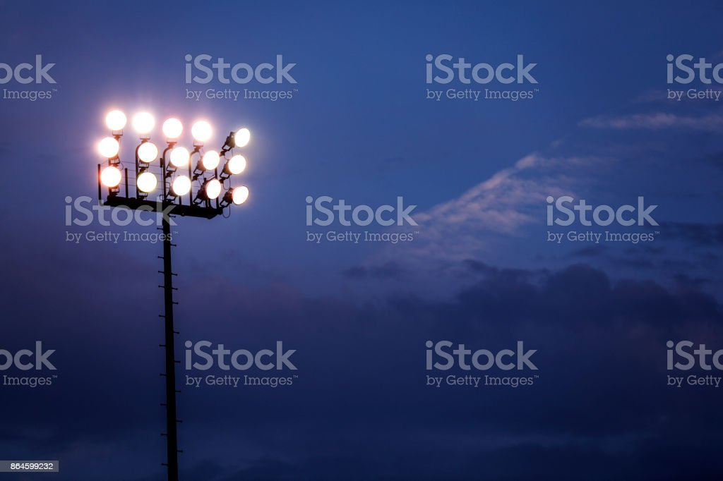 Sports stadium lights at dusk, night. stock photo