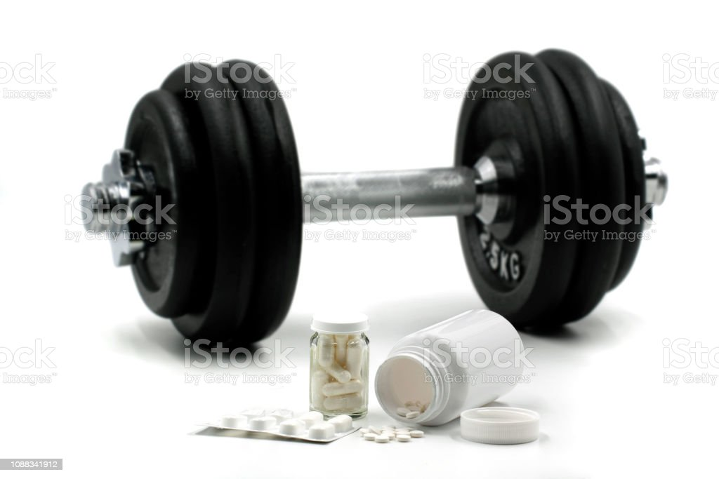 Sports supplements for bodybuilding with dumbbell on background isolated on white stock photo