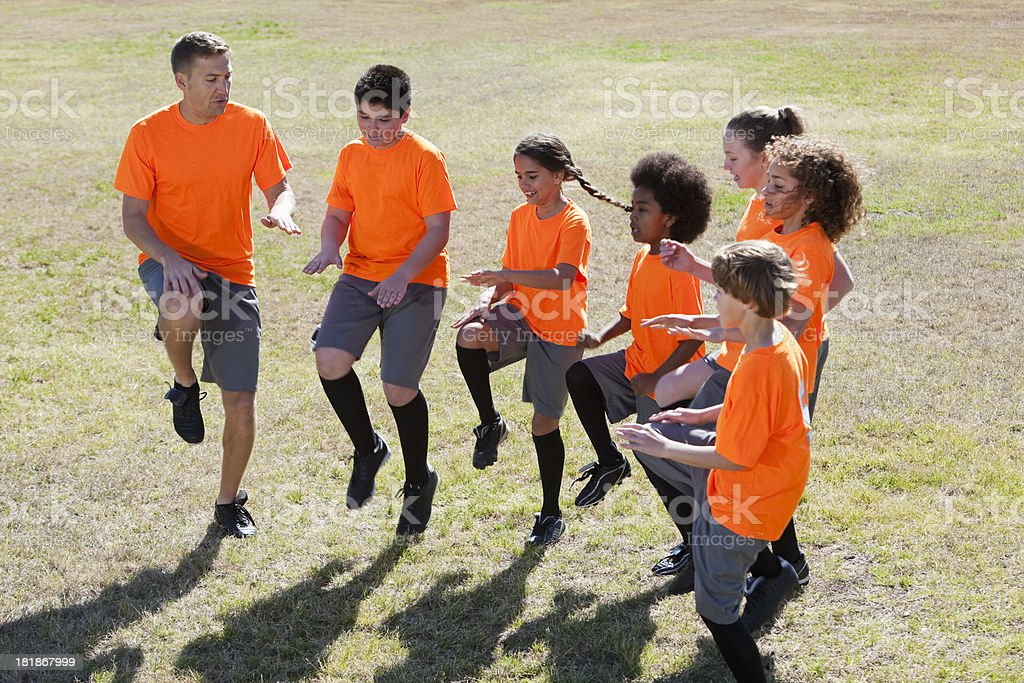 Sports team exercises royalty-free stock photo