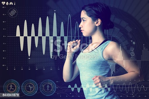 istock sports technology concept. running woman and various technological abstract graphics. sport science. 844341678
