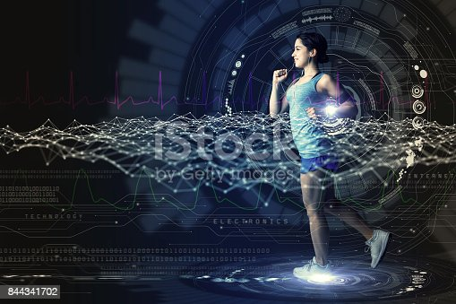 istock sports technology concept. running woman and various technological abstract graphics. sport science. 844341702