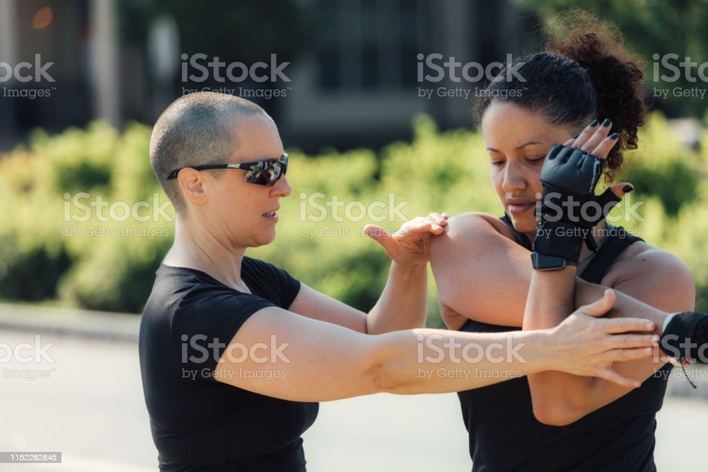 sports trainer helping athlete with stretching