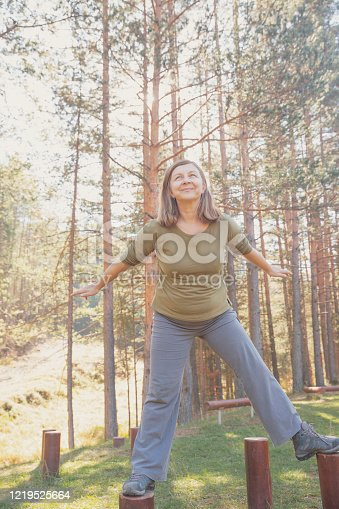 Sports training. Overweight woman working out in the mountains