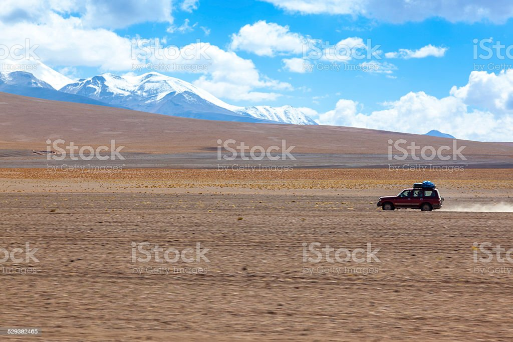 Sports Utility Vehicle driving in the Bolivian Altiplano stock photo