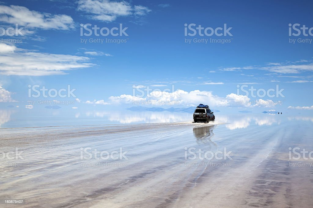 Sports Utility Vehicle driving in the Salar de Uyuni, Bolivia stock photo
