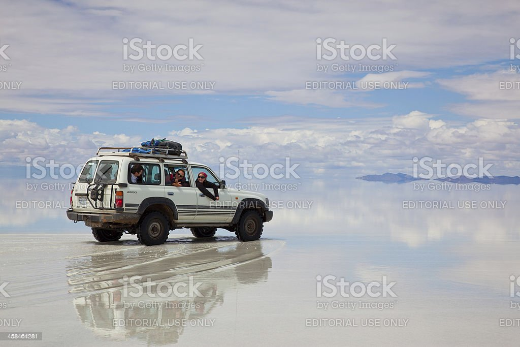 Sports Utility Vehicle driving in the Salar de Uyuni, Bolivia royalty-free stock photo