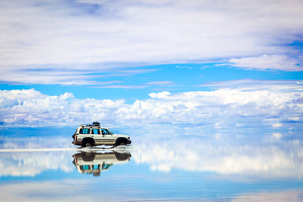sports utility vehicle driving in the salar de uyuni - south america travel stock photos and pictures