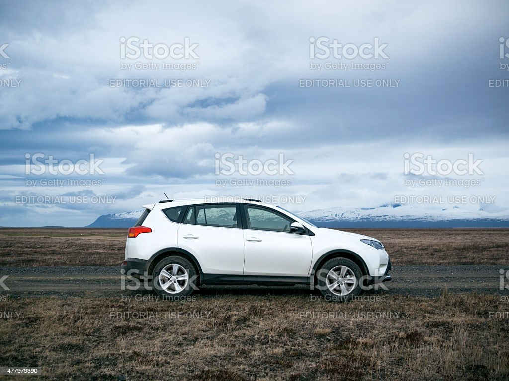 Sports Utility Vehicle, Icelandic road, mountainous backdrop stock photo