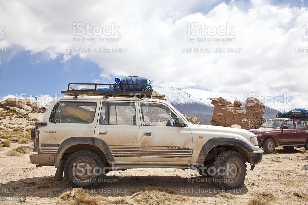 4x4 crossing the Bolivian Altiplano, people doing a trek in high...