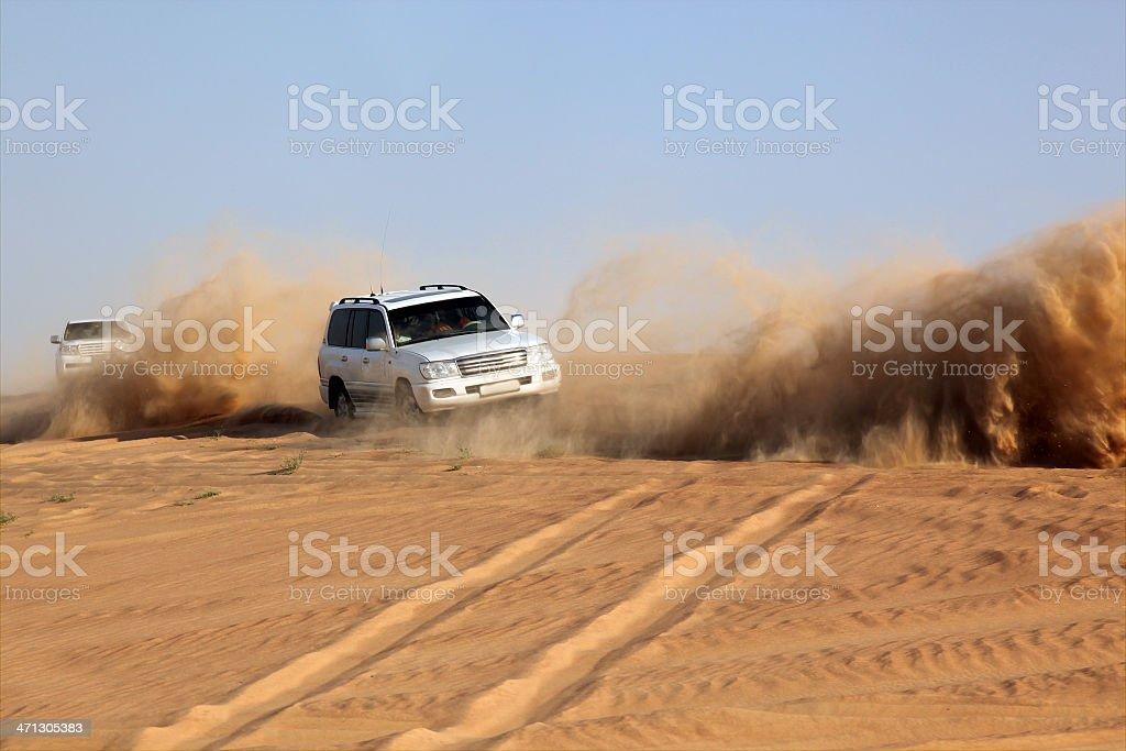 Sports Utility Vehicle speeding in desert sand, Dubai, UAE royalty-free stock photo