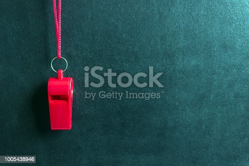 istock Sports whistle on a red lace.Concept- sport competition, referee, statistics, challenge, friendly match. 1005438946