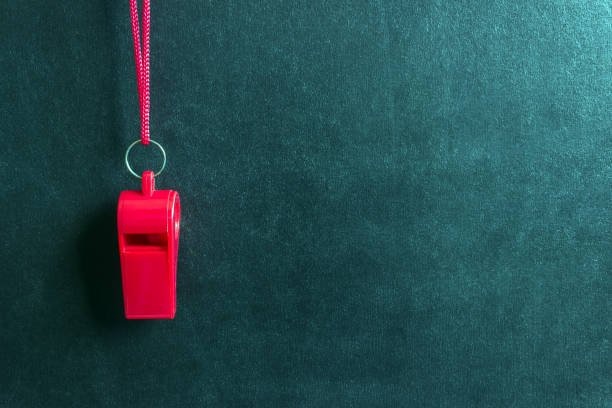 Sports whistle on a red lace.Concept- sport competition, referee, statistics, challenge, friendly match. Sports whistle on a red lace.Concept- sport competition, referee, statistics, challenge, friendly match.Copy space. referee stock pictures, royalty-free photos & images