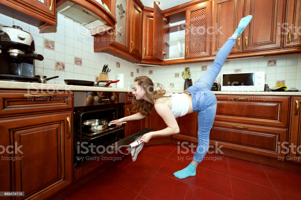 Sports woman in the kitchen. stock photo