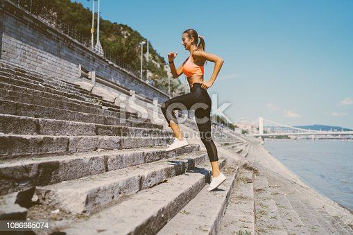 Young woman sports training at the staircase