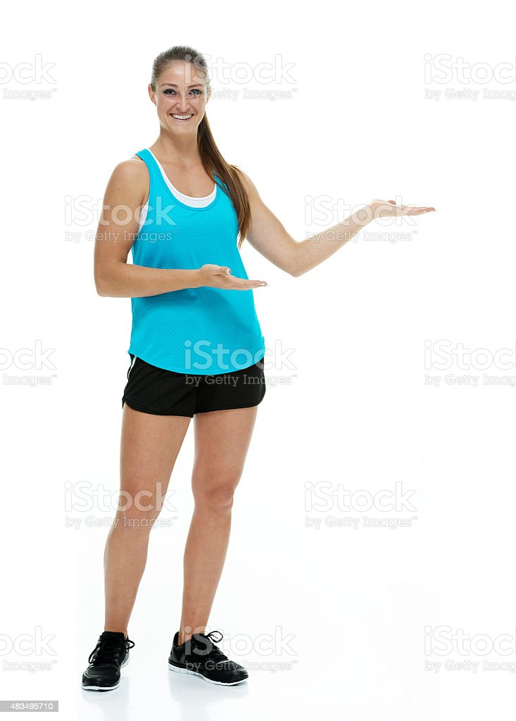 Sports woman showing something stock photo
