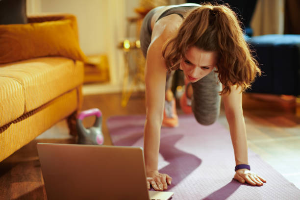 sports woman using online streaming fitness site stock photo