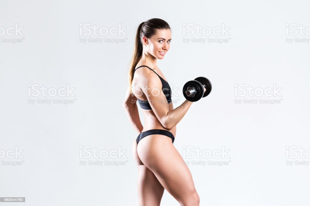 Sports woman with dumbbells. royalty-free stock photo