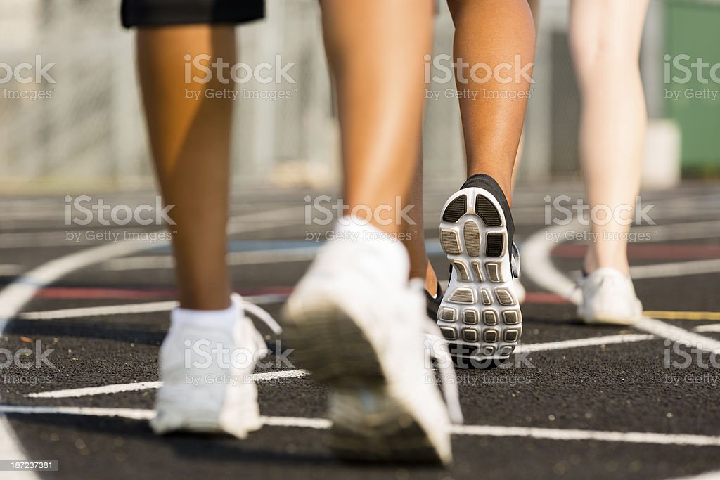 Sports:  Women exercise by walking around a track. stock photo