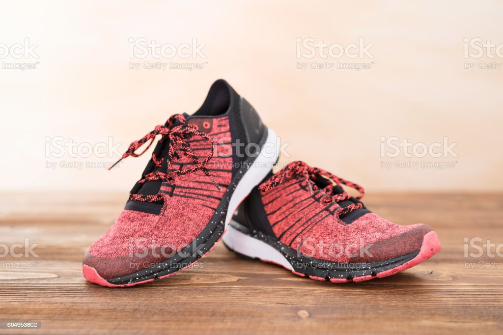 Sports workout shoes on wood floor stock photo