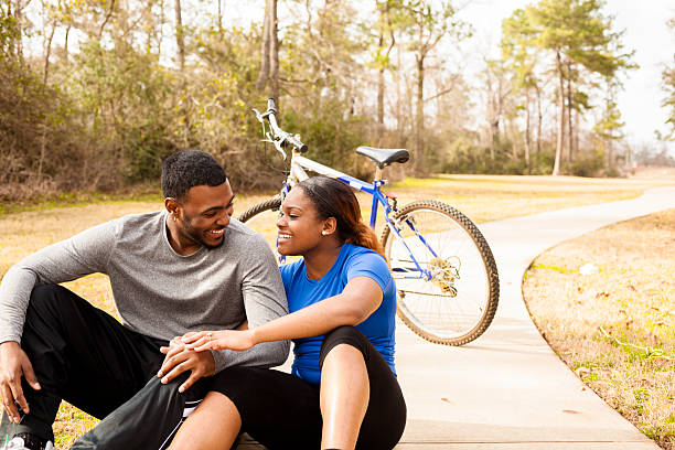 Sports: Young African descent couple take break from bike ride. stock photo