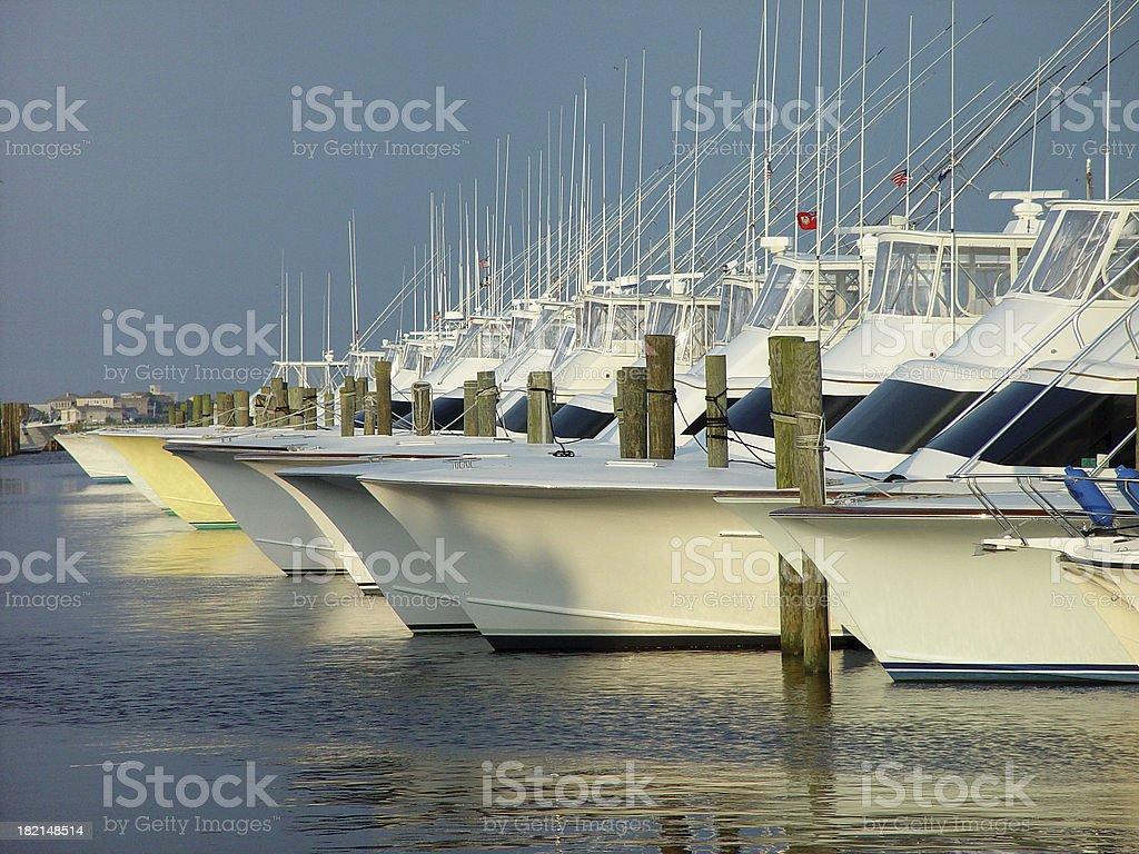 Sportsfishing Boats at sunset stock photo