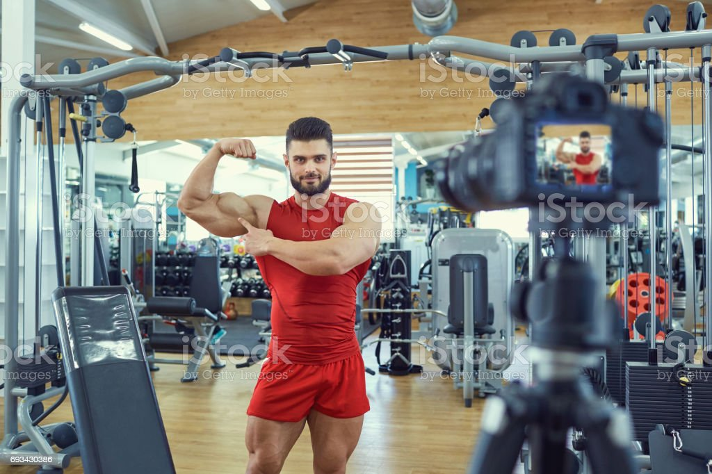 Sportsman athlete blogger does the video on the camera stock photo