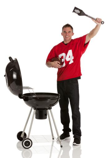 Sportsman barbecuing food