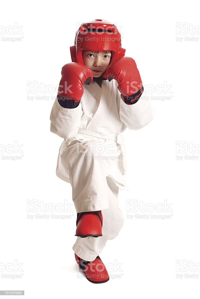 Young boy in kimono ready to fight over pure white background
