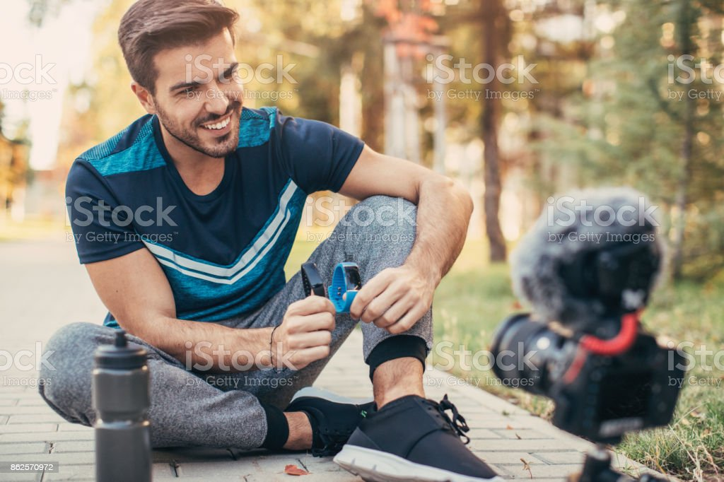 Sportsman doing a vlog about smart watches stock photo