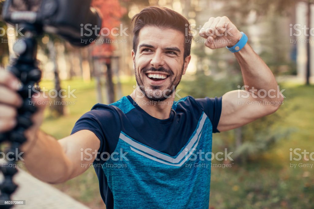 Sportsman doing a vlog stock photo