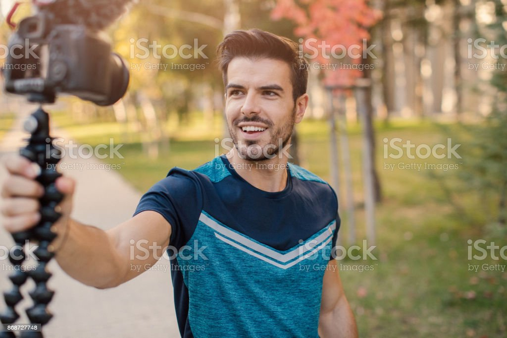 Sportsman doing a vlog stock photo