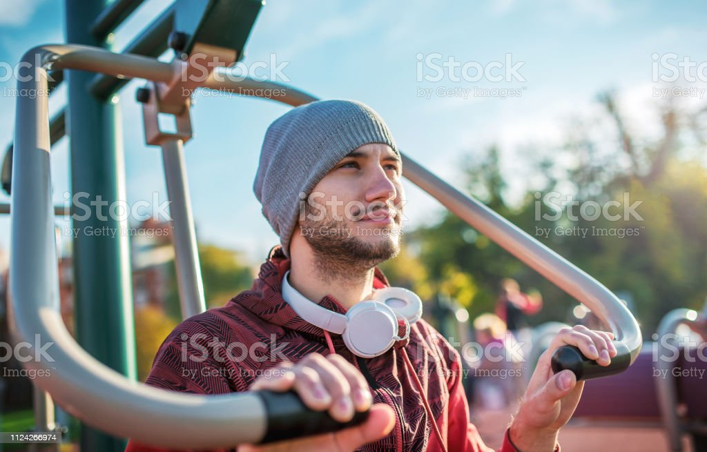 Young sportsman exercising outdoors. Sport, fitness, street workout...