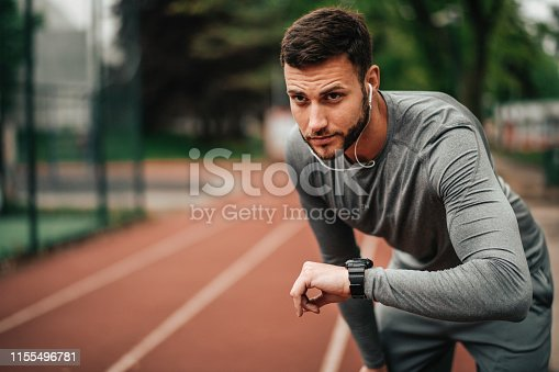 istock Sportsman. Exercising. Fitness lover. Body Building. Man doing exercise in park 1155496781