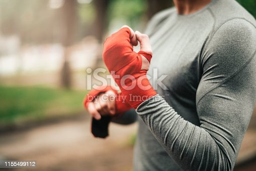 istock Sportsman. Exercising. Fitness lover. Body Building. Man doing exercise in park 1155499112