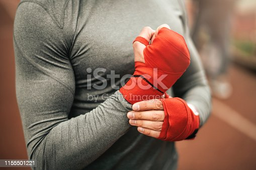 istock Sportsman. Exercising. Fitness lover. Body Building. Man doing exercise in park 1155501221