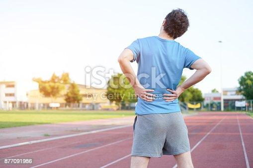 istock Sportsman feeling backache because of slipped disc 877091986