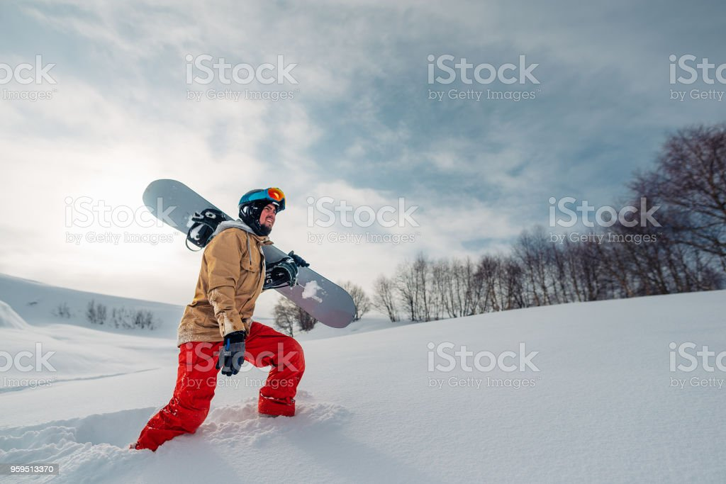 sportsman go with sowboard equpment stock photo
