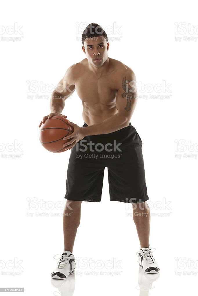 Sportsman holding a basketball royalty-free stock photo