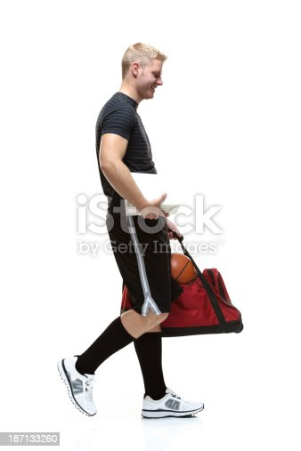 istock Sportsman holding gym bag and books 187133260