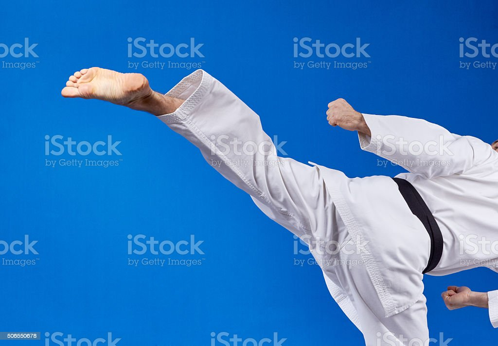 Sportsman is beating roundhouse blow stock photo